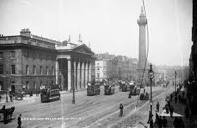 G. P. O, Sackville St. Dublin | https://commons.wikimedia.org/wiki/File:G.P.O._and_Nelson%27s_Pillar,_Sackville_St,_Dublin_by_Lawrence.jpg