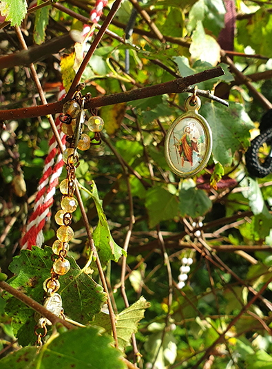 Medallions hung up in tree   Sara Nylund