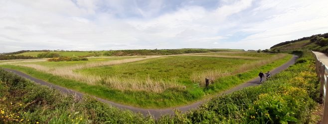 Panorama showing rock with obelisk on top, road and elevated path   Elizabeth Shee Twohig