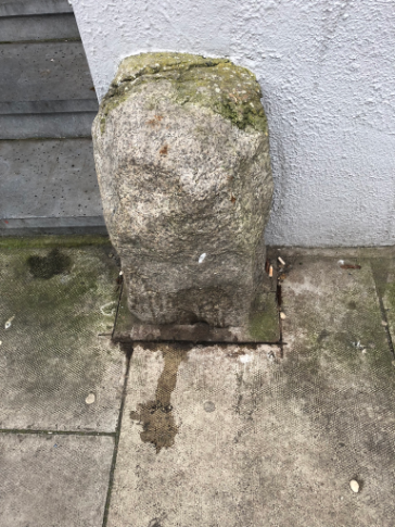 A truly strange stone cross outside an optician's on the corner of Kevin Street and Bride Street | Again, the cross
