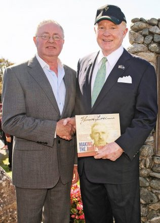 Mr. Edward Crawford, United States Ambassador to Ireland is presented with a copy of the book 'Making the Right Connections' by its author Michael Larkin. | Michael Larkin