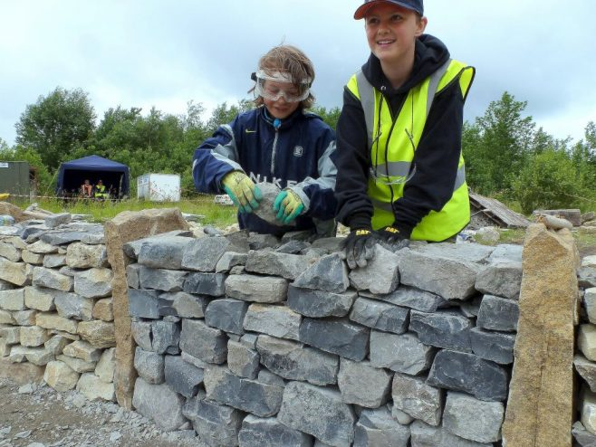 Future masons Óisín and Jacob build a bay for Connaugh during The Gathering of Stones event. | Louise Price