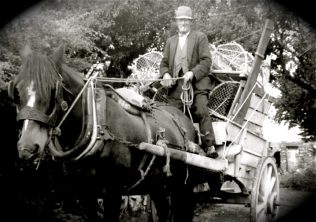 4.The authors grand-uncle Edmond 'Ned' O'Mahony pictured in c.1962 leaving Monatrea to head for Ferrypoint with lobster pots | Gerry O'Mahony