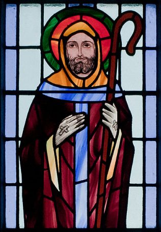 Detail of a stained glass window depicting St. Colman. in St Benin's Church, Galway | Andreas F. Borchert. Wikipedia Commons