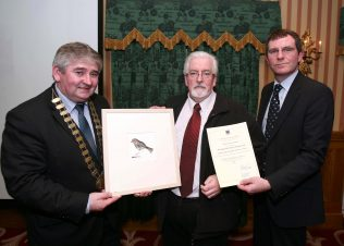 David Collins accepts the award on behalf of Oughterard Culture & Heritage Group