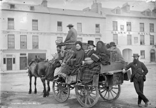 A Galway Mail Car, Eyre Square, c. 1880-1900. Black's Hotel may be seen in the right background of thei William Lawrence photograph. | Courtesy of the National Library of Ireland.