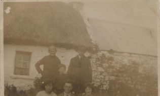 Tom's brother John and members of his family at the old house in Monagarraun   Cadden family