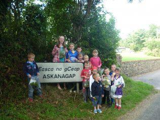 Askanagap sign with Children.   Askanagap Community Development Association
