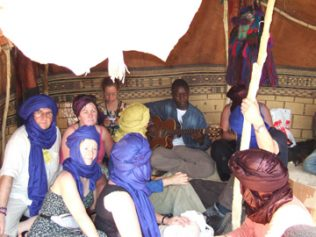 Jacqueline (back row, 2nd from left) and musicians in the desert   Photo: Jacqueline McCarthy