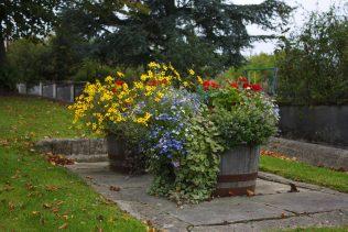 Flower barrells beside river | Dunlavin Tidy Towns