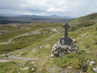 A stone cross marks circles of stones that form the Stations of the Cross | Aoife O'Toole