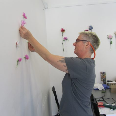 Breda Burns, artist hanging flowers | Aoife O'Toole