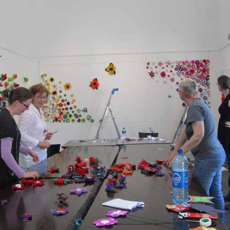 Staff from the Linenhall Art Centre installing exhibition at the National Museum | Aoife O'Toole