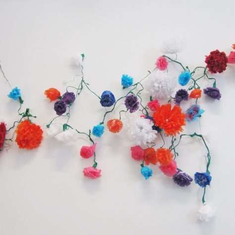 Paper flowers dipped in wax, made by women with the Mayo Traveller Support Group | Aoife O'Toole
