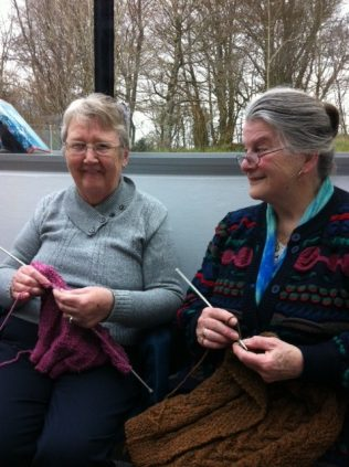 Mary O'Boyle knitting on left with Rosa McHugh on right