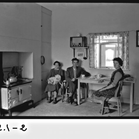 These people in 1950s Kinvara, Co. Galway have modernised not alone with electricity and radio but with a fine range too. The table is still pulled to the side in the traditional manner however and the hearth remains the traditional focus | Cresswell Collection NUIG