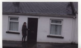 Ann standing at her father's home | Ann Kneafsey