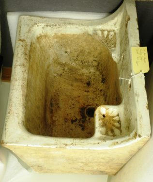 The Magdalen Laundry sink came from 'J. & M. Craig Limited, Kilmarnock', a clay-manufacturing company in Aryshire, Scotland established in 1828.  The maker's mark is still clearly visible between the two scallop-shaped soap holders.   Courtesy of Galway City Museum.