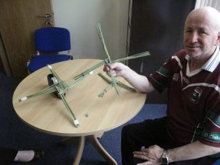 Making a St Bridget's cross in our centre