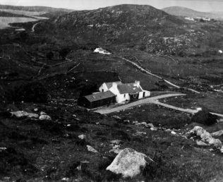 The cottage in Lettercaugh, with Lough Anure in the background.