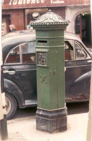 Penfold Pillarbox, Mainguard Street, Photograph, by Derek Biddulph, of the Penfold Pillar Box on the corner of High St and Mainguard St, Galway, c. 1980s. | Galway City Museum Collection.