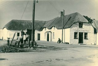 Lusk, Co. Dublin in 1943. This rural scene had the benefit of electricity at this early stage because it was near to Dublin. Most of the countryside had to wait until the 1950s and 1960s | National Museum of Ireland