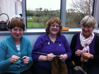 Breege Walsh sits in the middle between Mary Waters on the left and Mary Lavelle on the right